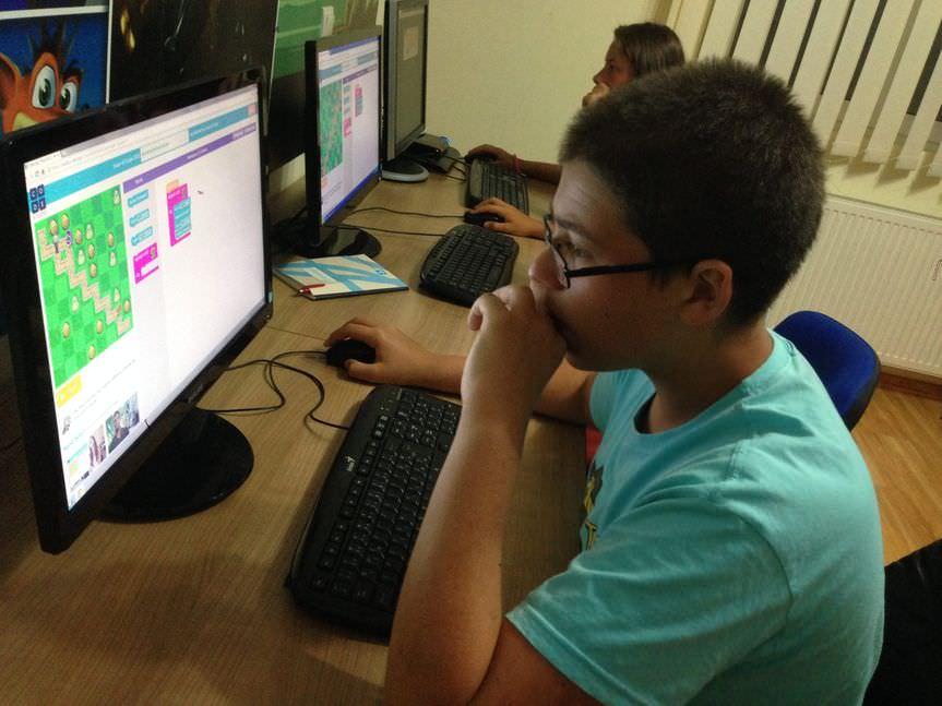 A boy, programming.