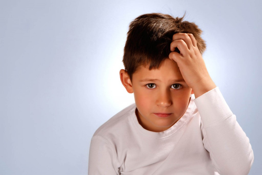 worried boy scratching his head; Shutterstock ID 53579857; PO: The Huffington Post; Job: The Huffington Post; Client: The Huffington Post; Other: The Huffington Post